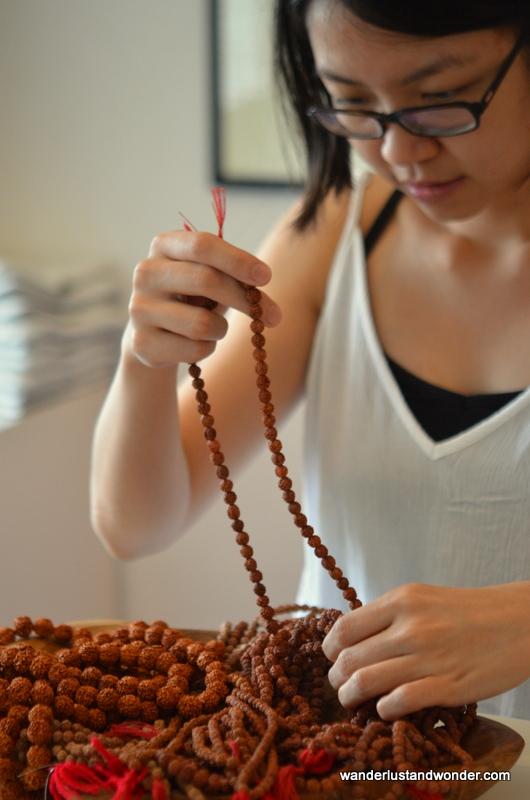 Fellow student Khim selecting her rudraksha beads.